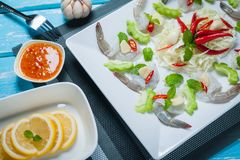 Raw shrimp and spicy sauce. Sea food  spicy salad shrimp in fish sauce Royalty Free Stock Image