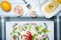Raw shrimp and spicy sauce. Sea food  spicy salad shrimp in fish sauce Stock Images