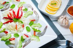 Raw shrimp and spicy sauce. Sea food  spicy salad shrimp in fish sauce Stock Photography