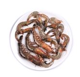 Raw shrimp on a white table Royalty Free Stock Photography