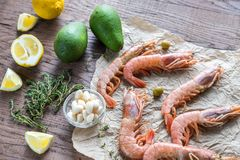 Raw shrimps with avocado and lemon wedges Royalty Free Stock Image