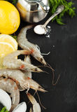 Raw Shrimps on ice with fresh dill and lemon Royalty Free Stock Photos