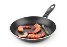 Raw shrimps on pan Stock Photos