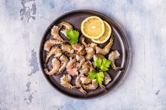 Raw shrimps with parsley and lemon. stock photos