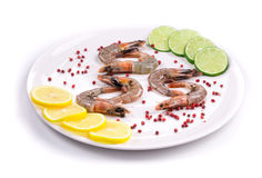 Raw shrimps on plate. Close up. Stock Image