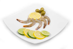 Raw shrimps on plate. Royalty Free Stock Photos