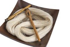 Raw silk yarn and spools Royalty Free Stock Photos