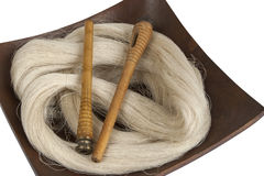 Raw silk yarn and spools Stock Images