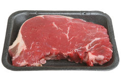 Raw Sirloin Beef Steak. Thick sirloin steak in a styrofoam packaging tray Royalty Free Stock Photography