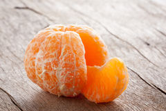 Raw skinned mandarin on wooden table Royalty Free Stock Images