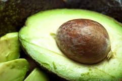 Raw sliced avocados Stock Photography