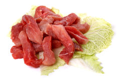 Raw sliced meat on a cabbage leaf Stock Photo