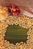 Raw small yellow macaroni pasta for cooking. Royalty Free Stock Photo
