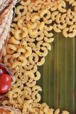 Raw small yellow macaroni pasta for cooking. Royalty Free Stock Photography
