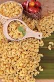 Raw small yellow macaroni pasta for cooking. Stock Photo