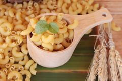 Raw small yellow macaroni pasta for cooking. Royalty Free Stock Image