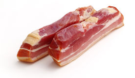 Raw smoked bacon. Isolated on the white background Stock Images