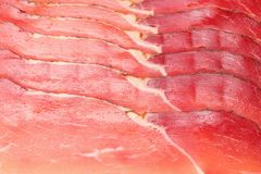 Raw smoked black forest ham background. ham texture. top view. macro royalty free stock photo