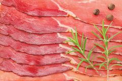 Raw smoked black forest ham background. ham texture. top view. macro stock photo