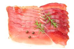 Raw smoked black forest ham with rosemary and peppercorns isolated on white background. top view stock images