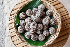 Raw snack balls from above. Raw snack balls, mixed healthy nuts and dried fruits with sesame seeds Stock Photo