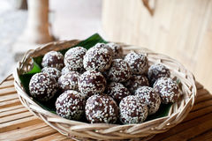 Raw snack balls. Mixed healthy nuts and dried fruits with sesame seeds Stock Image