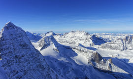 Raw of snow peaks in Jungfrau region helicopter view in winter Royalty Free Stock Images