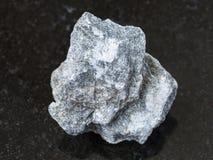 Raw Soapstone stone ( talc - schist ) on dark Royalty Free Stock Photos