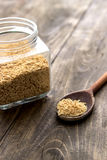 Raw soy flakes in wooden spoon Royalty Free Stock Images