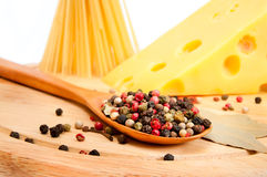 Raw spaghetti with cheese and spices Stock Photos