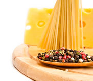 Raw spaghetti with cheese and spices Stock Images