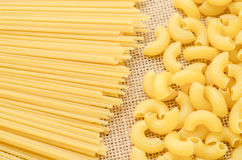 Raw Spaghetti and elbow macaroni. Stock Photos