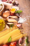 Raw spaghetti. With fresh ingredients Royalty Free Stock Images