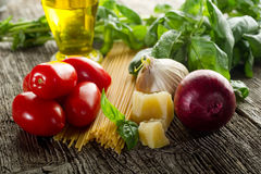 Raw spaghetti with ingredients Royalty Free Stock Images