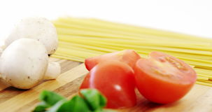 Raw spaghetti with ingredients stock video