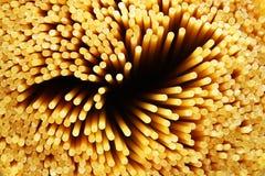 Raw spaghetti noddles closeup. Closeup of raw spaghetti pasta Stock Photo