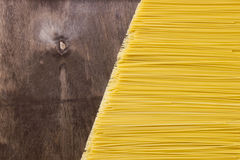 Raw spaghetti noodles. On a wooden background Stock Photos
