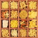 Raw spaghetti and pasta in  box Stock Photo