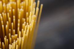 Raw Spaghetti pasta closeup. On wooden table Stock Image