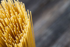 Raw Spaghetti pasta closeup. On wooden table Royalty Free Stock Photo