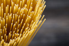 Raw Spaghetti pasta closeup. On wooden table Royalty Free Stock Photography