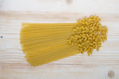 Raw spaghetti pasta. On the table beautifully laid out unprepared pasta Royalty Free Stock Images