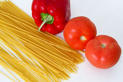 Raw spaghetti pasta and vegetables. Spaghetti pasta and vegetables for Italian cooking Stock Image