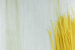 Raw Spaghetti or Pasta on White Wood Background Texture. Royalty Free Stock Photography