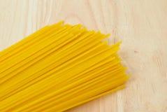 Raw spaghetti on wood  background. Royalty Free Stock Photos