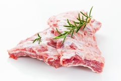 Raw spare ribs with rosemary Royalty Free Stock Photo