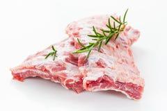Raw spare ribs with rosemary royalty free stock photo
