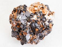Raw Sphalerite with Galena ore on white marble. Macro shooting of natural mineral rock specimen - raw Sphalerite with Galena ore on white marble background from Royalty Free Stock Image
