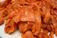 Raw spicy pickled chicken slice Stock Images