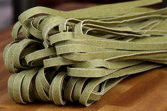 Raw spinach fettuccine Stock Image